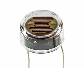 Image of a typical leaded light dependent resistor, LDR or photoresistor showing the resistive element